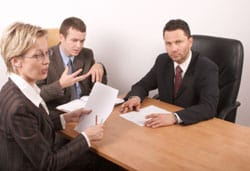 People sitting at a comference table in mediation