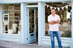 Self-employed man outside a shop