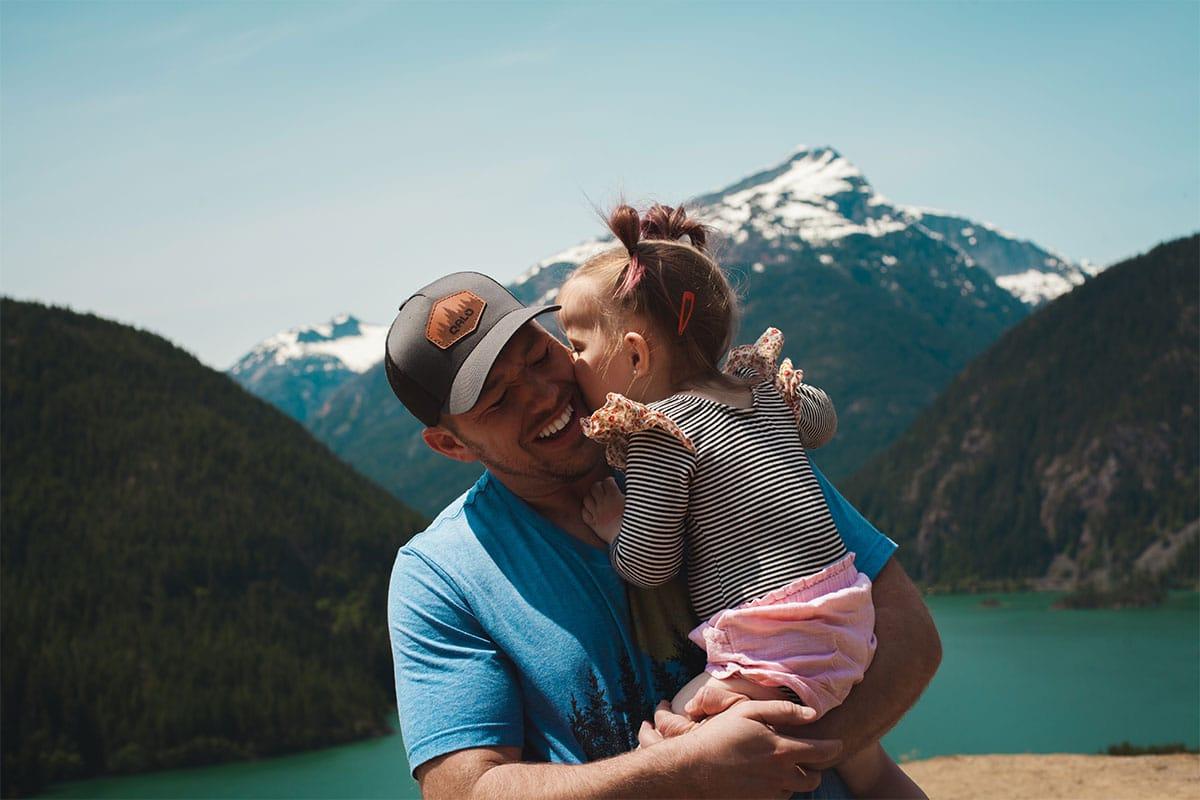Man carrying daughter - life after divorce