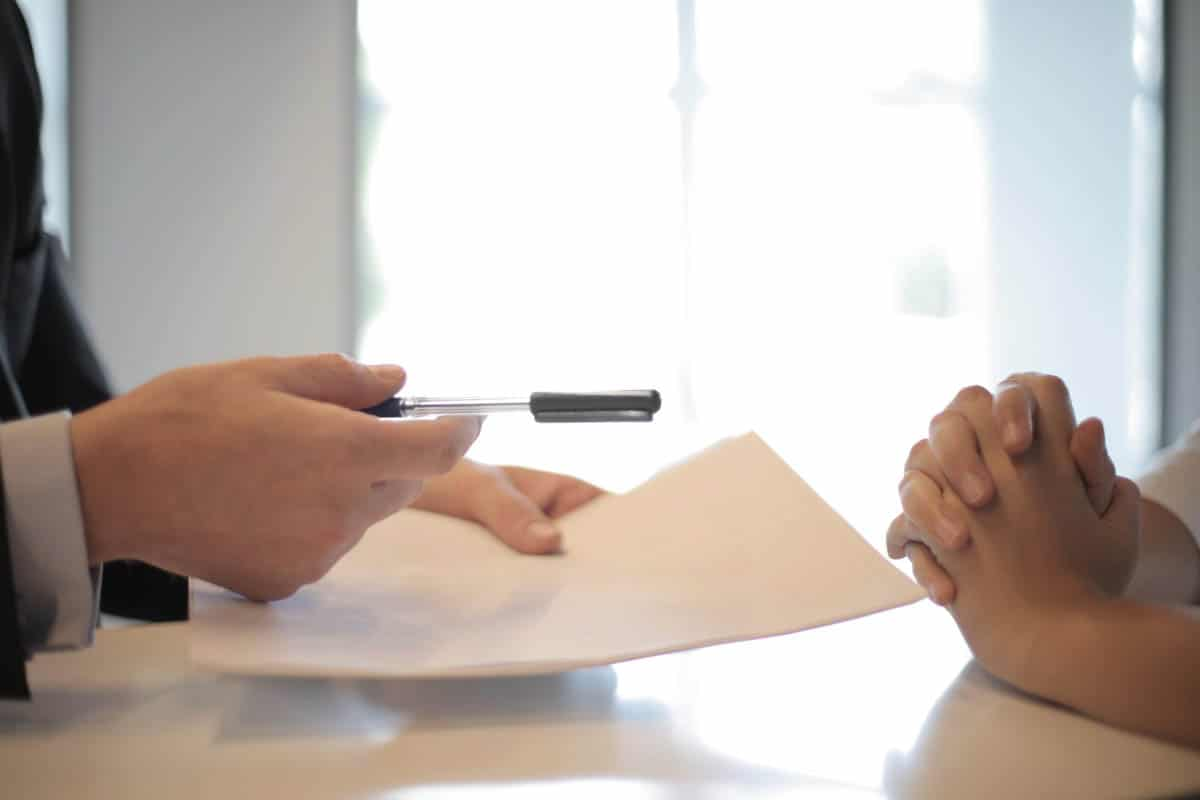 Person discussing with a lawyer why they need a will