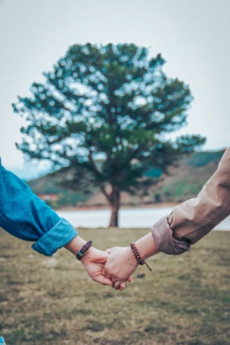 Common law couple holding hands