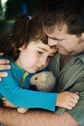 Dad hugging sad daughter