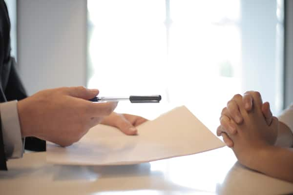 Couple signing domestic contract