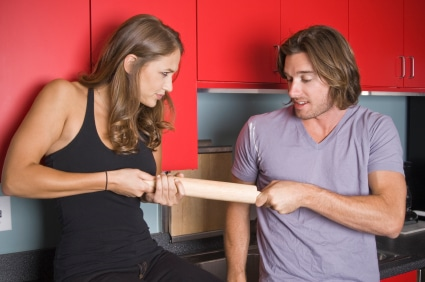 Couple fighting over household contents