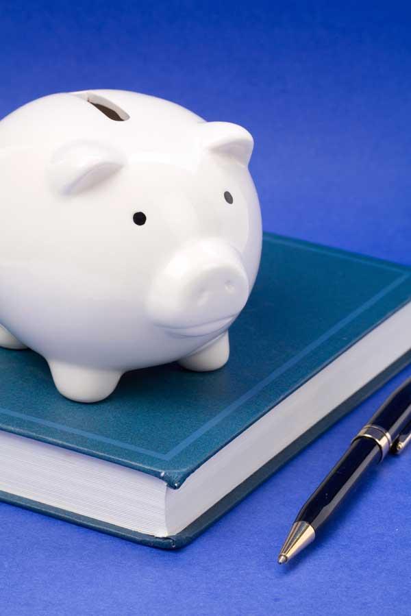 Piggy bank and textbook
