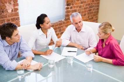 Couple having a four-way meeting to resolve their divorce