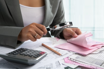 Woman doing the math on her financial disclosure